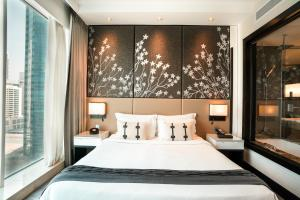 A bed or beds in a room at Pullman Dubai Downtown
