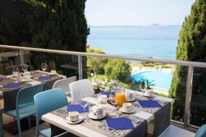 Restaurant ou autre lieu de restauration dans l'établissement Hotel Astarea