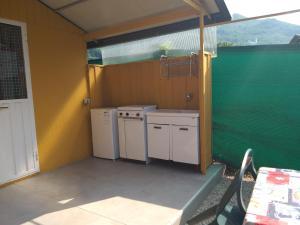 A kitchen or kitchenette at Camping Hotel Au Lac De Como
