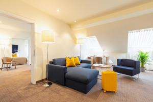 A seating area at HiLight Suites Hotel