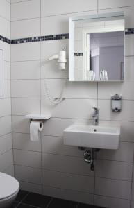 A bathroom at Go Hotel Saga