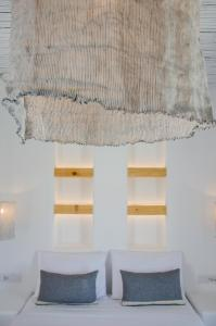 A bed or beds in a room at Yialos Ios Hotel