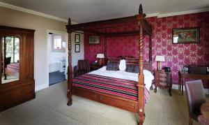 A bed or beds in a room at The Museum Inn
