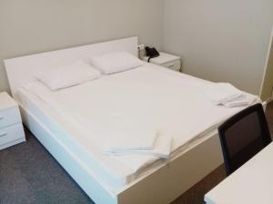 Cama ou camas em um quarto em Gabala Hotel