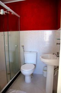 Um banheiro em Pousada Luzes de Geribá