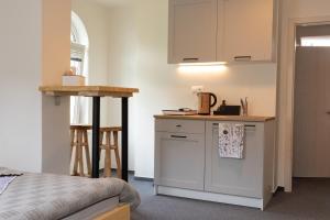 Kuchyňa alebo kuchynka v ubytovaní Treehouse Apartments