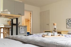 Posteľ alebo postele v izbe v ubytovaní Treehouse Apartments