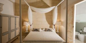 Letto o letti in una camera di Palazzo Dei Dondoli