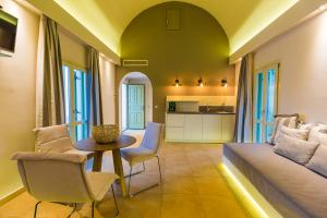 A seating area at Anassa Deluxe Suites