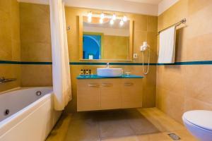 A bathroom at Anassa Deluxe Suites