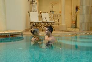 The swimming pool at or near Hotel Alle Alpi