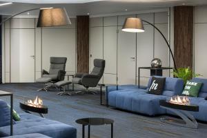 Ein Sitzbereich in der Unterkunft Best Western SeePark Hotel Murten