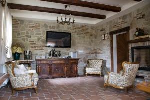 Predel za sedenje v nastanitvi Guesthouse & Apartments PRI STANI
