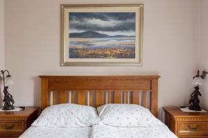Postelja oz. postelje v sobi nastanitve Guesthouse & Apartments PRI STANI