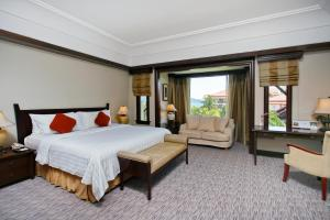 A bed or beds in a room at The Magellan Sutera Resort