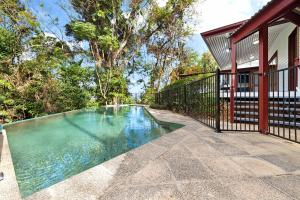 The swimming pool at or near Poinciana Lodge