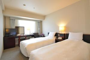 A bed or beds in a room at Castle Plaza