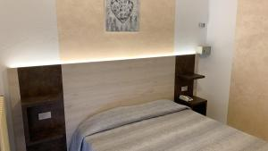 A bed or beds in a room at Albergo Gilda