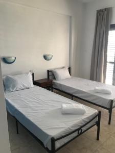 Un ou plusieurs lits dans un hébergement de l'établissement Athinas Court