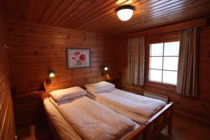 Een bed of bedden in een kamer bij Hapimag Ferienwohnungen Punkaharju