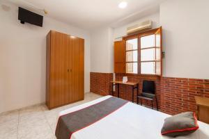 Un ou plusieurs lits dans un hébergement de l'établissement OYO El Rincón