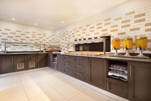 A kitchen or kitchenette at Ramada East Kilbride