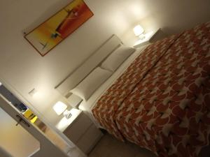 A bed or beds in a room at Casa Vacanze Basso
