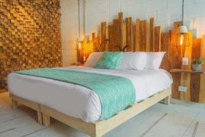 Un ou plusieurs lits dans un hébergement de l'établissement Nomads Hotel & Beachclub