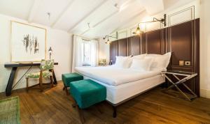 Ein Bett oder Betten in einem Zimmer der Unterkunft Hotel Cort