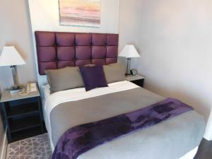 A bed or beds in a room at The Gould Hotel