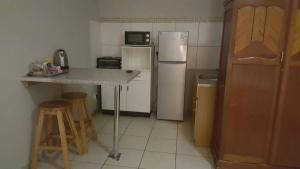 A kitchen or kitchenette at TANIA'S ACCOMODATION