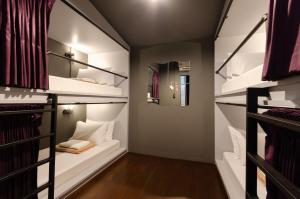 A bunk bed or bunk beds in a room at Tian Tian Hostel