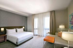 A bed or beds in a room at Hyatt Place Dubai Wasl District
