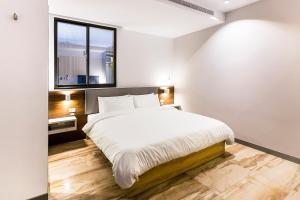 吉泰旅店 房間的床