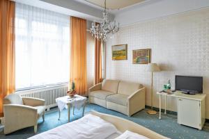 Χώρος καθιστικού στο Hotel Pension Baronesse
