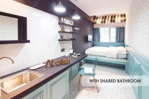 A kitchen or kitchenette at The Atelier Boutique Hotel
