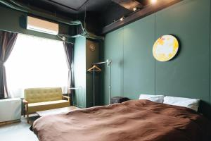 A bed or beds in a room at Tune Hakodate Hostel & MusicBal