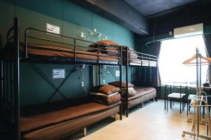 A bunk bed or bunk beds in a room at Tune Hakodate Hostel & MusicBal