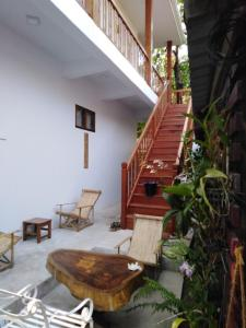 A porch or other outdoor area at Mingalarpar Ngapali Guest House
