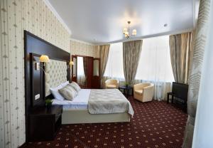 Кровать или кровати в номере Business Hotel Arbat