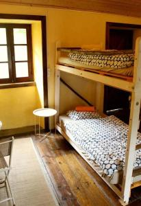 A bunk bed or bunk beds in a room at Watermill Moinho Garcia
