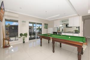 A pool table at Modern Luxury Ocean Views
