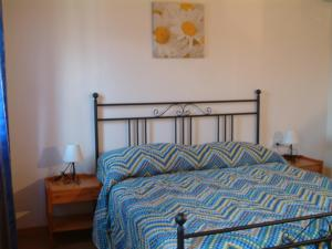 A bed or beds in a room at Agriturismo ai Casali