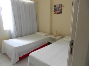 A bed or beds in a room at Apartamentos Verano