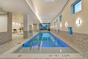 The swimming pool at or near Home2 Suites By Hilton Montreal Dorval