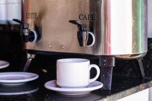 Comodidades para preparar café e chá em Pousada Badejo
