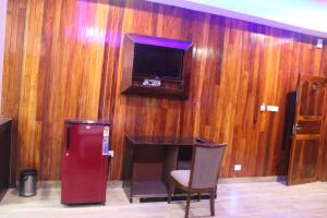 A television and/or entertainment centre at Tango Beach Resort