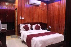 A bed or beds in a room at Tango Beach Resort