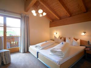 A bed or beds in a room at Appart Altana
