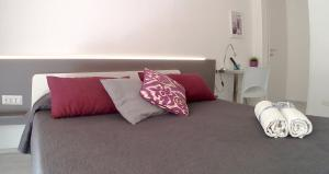 A bed or beds in a room at Be Inn